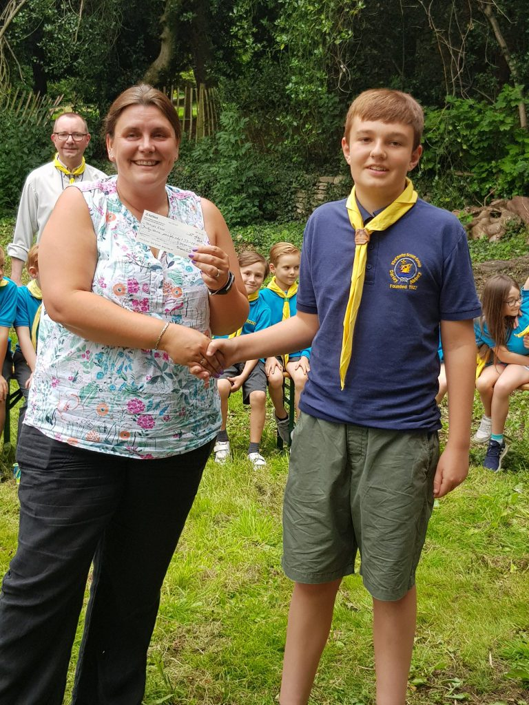 Ben presents a cheque to Tracey who won the June 2019 draw
